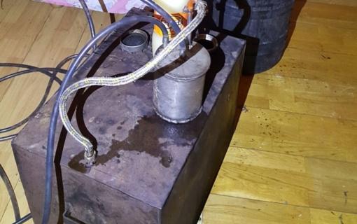 Jonavos rajono gyventojo namuose rastas aparatas naminei degtinei gaminti