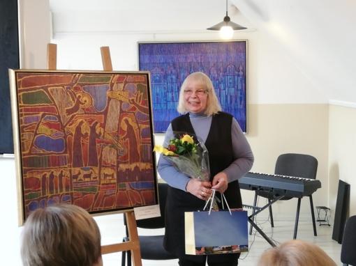 Lietuviško tapatumo atspindžiai E. Taločkienės paveiksluose
