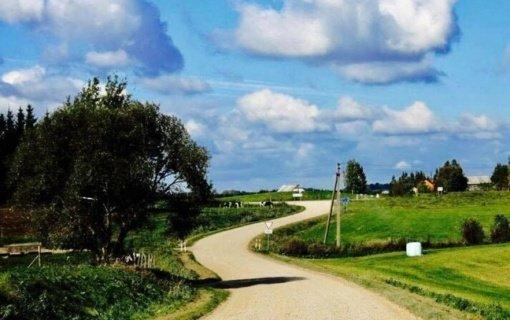 76 parlamentarai ragina nedelsiant parengti žvyrkelių per Lietuvos gyvenvietes asfaltavimo programą