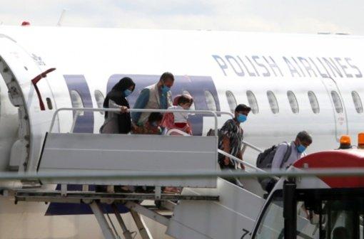 Afganistaniečiai vaikai ir suaugusieji mokysis lietuvių kalbos