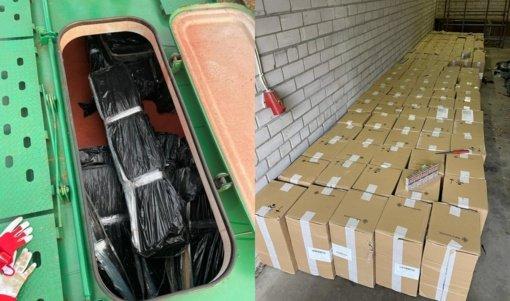 Baltarusiškas trąšas gabenusiame traukinyje pasieniečiai aptiko stambų kontrabandinių cigarečių krovinį